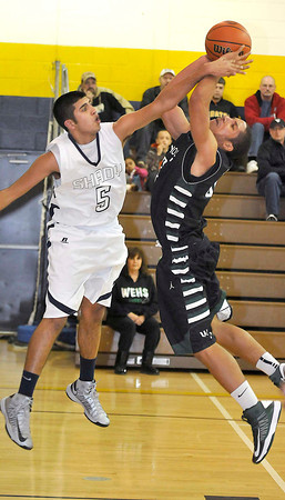 Shady Spring Steven Chhabra fouls Wyoming East Josh Tunstalleduring there game on Tuesday at Shady Spring High School. Photo by Chris Tilley
