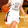F. BRIAN FERGUSON/THE REGISTER-HERALD= Woodrow Wilson's Sarah Akers brings the ball down court during Wednesday evening action in Beckley.