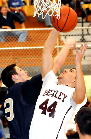F. BRIAN FERGUSON/THE REGISTER-HERALD=Shady Spring's Chase Conner, left, and Woodrow Wilson's Brent Osborne, right, fight for the rebound during Wednesday evening action in Bluefield.