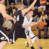 Chase Conner, of Shady Spring, tries to get around Levi Lambert, of Westside.<br /> Rick Barbero/The Register-Herald