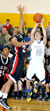 Shady Spring Jordan Meadows take a jumper while Oak Hills Kyalo Bradford tries to block the shoot on Monday at Shady Spring High School. Photo by Chris Tilley