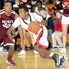 F. BRIAN FERGUSON/THE REGISTER-HERALD=Woodrow Wilson takes on Oak Hill during Thursday evening action in Oak Hill.