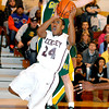 Woodrow Wilsons Donte Nabors goes in for the shoot with Greenbrier East Dereck Welfred tring to contect the shoot duing Friday nights game in Bluefield. Photo by Chris Tilley