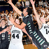 F. BRIAN FERGUSON/THE REGISTER-HERALD=Wyoming East's #24 goes up for a shot as Westside's Justin Cogar, left, and Corey Bowles defend during Thursday evening action in Beckley.