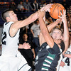 F. BRIAN FERGUSON/THE REGISTER-HERALD=Wyoming East's #24 has his shot blocked by Westside's Justin Cogar, left, and Corey Bowles during Thursday evening action in Beckley.