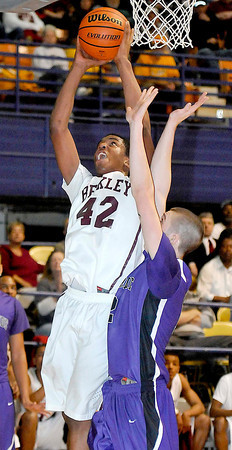 Woodrow Wilsons Nequan Carrington takes the ball to the basket during there match up with Riverside High School at the Beckley Convention Center Tuesday. Photo by Chris Tilley