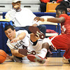 Brent Osborne, left, of Woodrow Wilson  and Rasaan Harris, of Hurricane go after a loose ball during the boys state quarter final game at the Charleston Civic Center Wednesday morning.<br /> Rick Barbero/The Register-Herald
