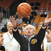 Hall of Fame coach and Mullens native Lewis D'Antoni, 99, throws up the ceremonial jump ball to start off the 100th W.Va. state high school boys basketball tournament in Charleston Wednesday morning. Getting ready to jump is Dylan Rich of Buffalo, left, and Nick George of Charleston Catholic.