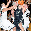 F. BRIAN FERGUSON/THE REGISTER-HERALD=Wyoming East's #40 is defended by Westside's Justin Cogar, left, Corey Bowles, and Matt Harless during Thursday evening action in Beckley.