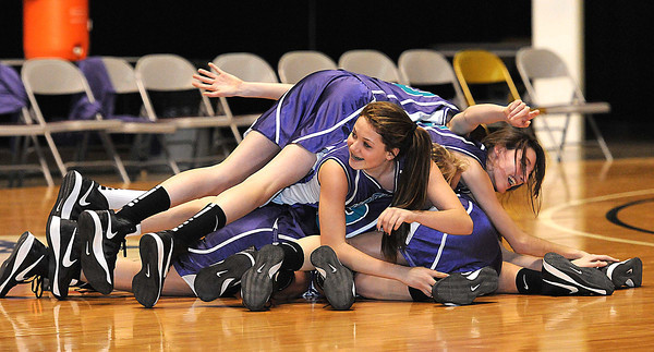 Eastern Greenbrier Middle School girls celebrate after beating Shady Spring Middle School during the Big Atlantic Classic championship game at the Beckley-Raleigh County Convention Center.<br /> Rick Barbero/The Register-Herald