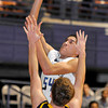 Greenbrier West Josh Martin shoots over Garrett Keller of Morrefield High School  during the Big Atlantic Classic Tuesday at the Beckley Convention Center. Photo By Chris Tilley