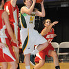 Bianca Andre, 33, of Greenbrier East, drives between two University High School defenders during the Big Atlantic Classic Class AAA championship game at the Beckley-Raleigh County Convention Center.<br /> Rick Barbero/The Register-Herald