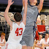 Valley's Zac Warden goes in for the jumper over Tygarts Valley Ben Sycafoose  during The Big Atlantic Classic at the Beckley Convention Center. Photo by Chris Tilley