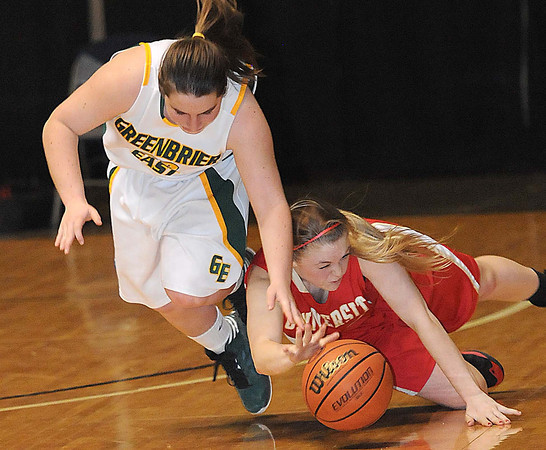 Lexi Tincher, 23, of Greenbrier East, left, and Megan Messiora, 20, of  University High School, dive for a loose ball during the Big Atlantic Classic Class AAA championship game at the Beckley-Raleigh County Convention Center.<br /> Rick Barbero/The Register-Herald