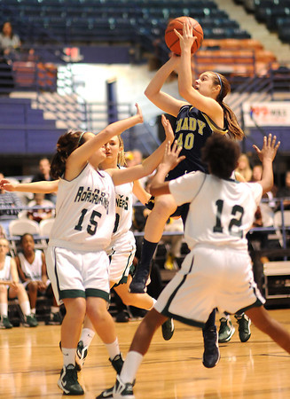 Abigail Gwinn, 40, of Shady Spring Middle School, drives to the basket between three Park Middle school defenders, during the Big Atlantic Classic game at the Beckley- Raleigh County Convention Center.<br /> Rick Barbero/The Register-Herald.com
