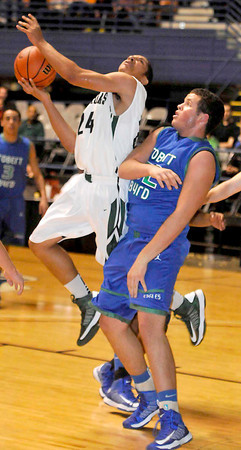 Wyoming East Josh Tunstalle draws the foul from Robert C Byrd High's Justin Noble in their match up during the Big Atlantic Classic Tuesday at the Beckley Convention Center. Photo By Chris Tilley
