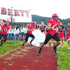 The Liberty High School football team burts on to the field in their season opening game with Westside Friday night.