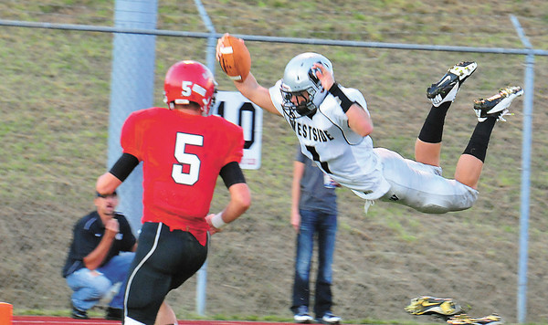 Westside's Justin Cogar, dives into the endzone in Friday nights game with Liberty High School.