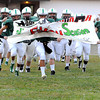 F. BRIAN FERGUSON/THE REGISTER-HERALD=Fayetteville's Pirates take the field for the first time this season during Friday action in Fayetteville. Aug. 24, 2012.