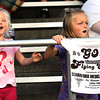 Laney Garcia, 5, daughter of Mark and Marybeth Garcia, of Beckley, cheer during the Woodrow Wilson vs Princeton game at Van Meter Stadium in Beckley Friday evening.<br /> Rick Barbero/The Register-Herald