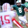 F. BRIAN FERGUSON/THE REGISTER-HERALD=Fayetteville QB Aaron Krise picks up some yards against Wahama during Friday action in Fayetteville. Aug. 24, 2012.
