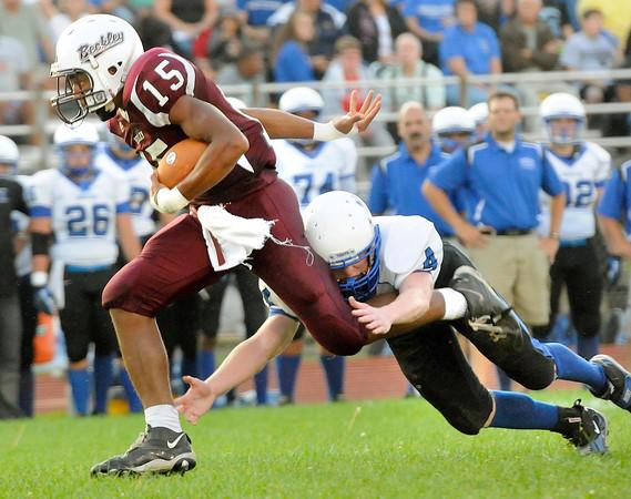 Chase Hancock, 15, Woodrow Wilson, breaks away from Aaron Saunders, 4, of Princeton at Van Meter Stadium in Beckley Friday evening.<br /> Rick Barbero/The Register-Herald