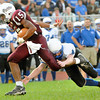 Chase Hancock, 15, Woodrow Wilson, breaks away from Aaron Saunders, 4, of Princeton at Van Meter Stadium in Beckley Friday evening.<br /> Rick Barbero/The Register-Herald