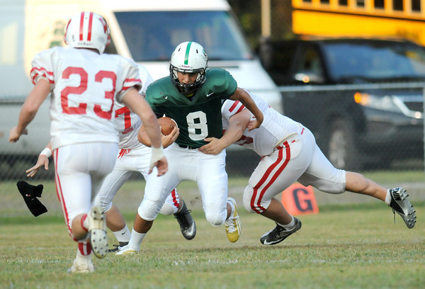F. BRIAN FERGUSON/THE REGISTER-HERALD=Fayetteville takes on Wahama during Friday action in Fayetteville. Aug. 24, 2012.