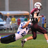 Tyhler Cook, 80, Woodrow Wilson, gets tackled by Chad Wyrick, 21, of Princeton at Van Meter Stadium in Beckley Friday evening<br /> Rick Barbero/The Register-Herald