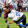 Ramon Edwards III, 5, of Woodrow Wilson, tries to break away from Chad Wyrick, 21, of Princeton at Van Meter Stadium in Beckley Friday evening<br /> Rick Barbero/The Register-Herald