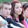 F. BRIAN FERGUSON/THE REGISTER-HERALD=Fayetteville fans, from left, Erica Hogan, Dustin Shumaker, Hali Price, and MalloryMeadows watch as their Pirates struggled against Wahama during Friday action in Fayetteville. Aug. 24, 2012.