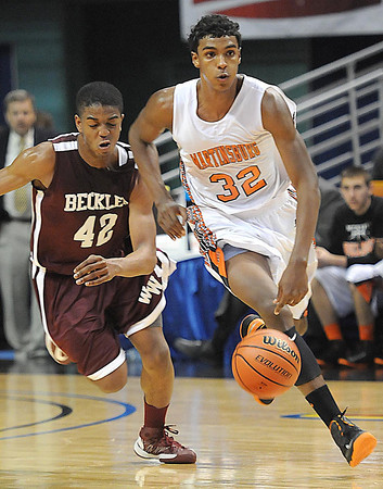 Nequan Carrington, of Woodrow Wilson, tries to catch up with, Donte' Grantham, of Martinsburg in the Boys State AAA Championship game at the Charleston Civic Center Saturday night.<br /> Rick Barbero/The Register-Herald