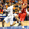 Jalen Breckenridge, left, of Woodrow Wilson guards Trey Dawson of Hurricane during the boys state quarter finals game at the Charleston Civic Center Wednesday morning.<br /> Rick Barbero/The Register-Herald