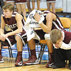 Corey Acord, left, Andrew Johnson and Mark Cole of Woodrow Wilson showing disappointment after getting beat Martinsburg in the Boys State AAA Championship game at the Charleston Civic Center Saturday night.<br /> Rick Barbero/The Register-Herald