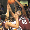 Nequan Carrington, 42, of Woodrow Wilson, grabs a rebound away from, David Long, 25, of Martinsburg, in the Boys State AAA Championship game at the Charleston Civic Center Saturday night.<br /> Rick Barbero/The Register-Herald