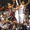 Chase Hancock, of Woodrow Wilson, tries to shoot of, Donte' Grantham, of Martinsburg, in the Boys State AAA Championship game at the Charleston Civic Center Saturday night.<br /> Rick Barbero/The Register-Herald