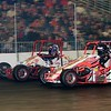 RAD Racing teammates Dave Darland and Jon Stanbrough do battle in front of a packed house.
