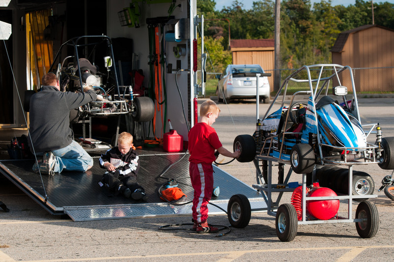 Father and sons working on the kids' race cars at Oakland County Sportsman's Club.e