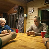 A classic deer camp scene . . . cards in the cabin.