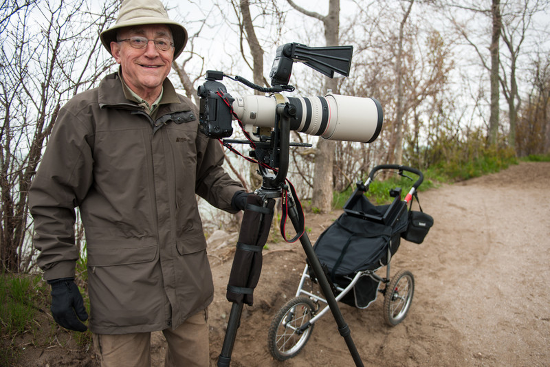 This man designed (and had manufactured) the clamps and brackets on his 3-wheel trolley to haul his camera and tripod.  He designed and fabricated the flash mount himself.