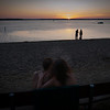 A couple watching the sunset, Lake Mitchell, near Cadillac, Michigan