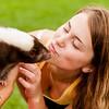 Girl kissing a skunk.