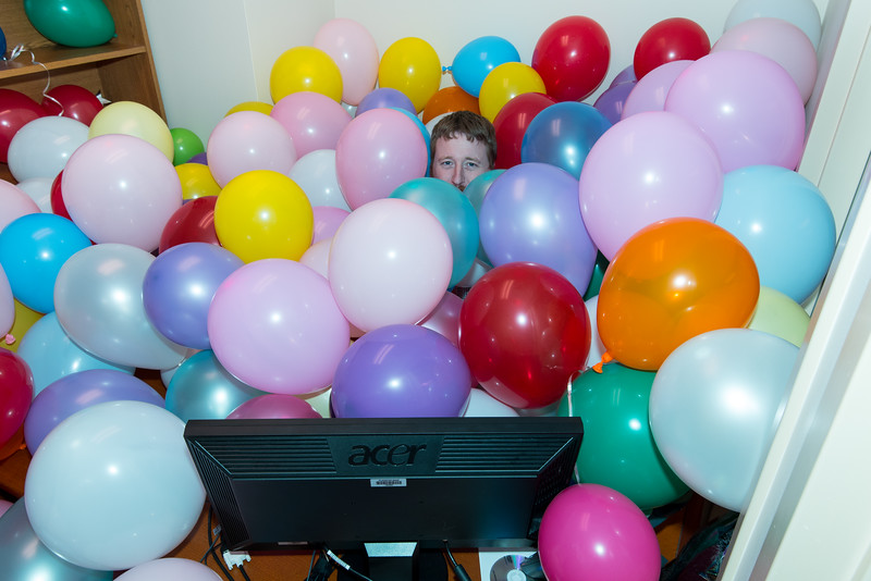 A mischeivous coworker filled his boss's office with balloons.