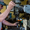 My dad upgrading the support on one of my lenses.