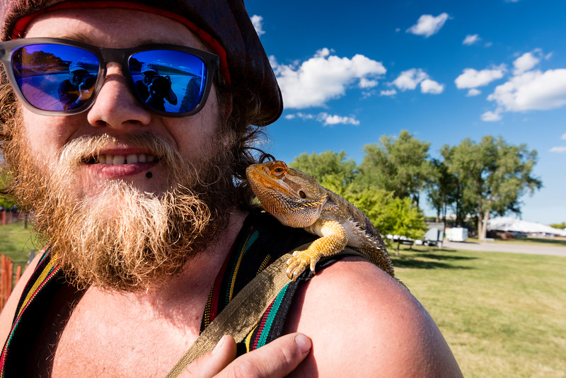 Dude with a lizard on his shoulder.