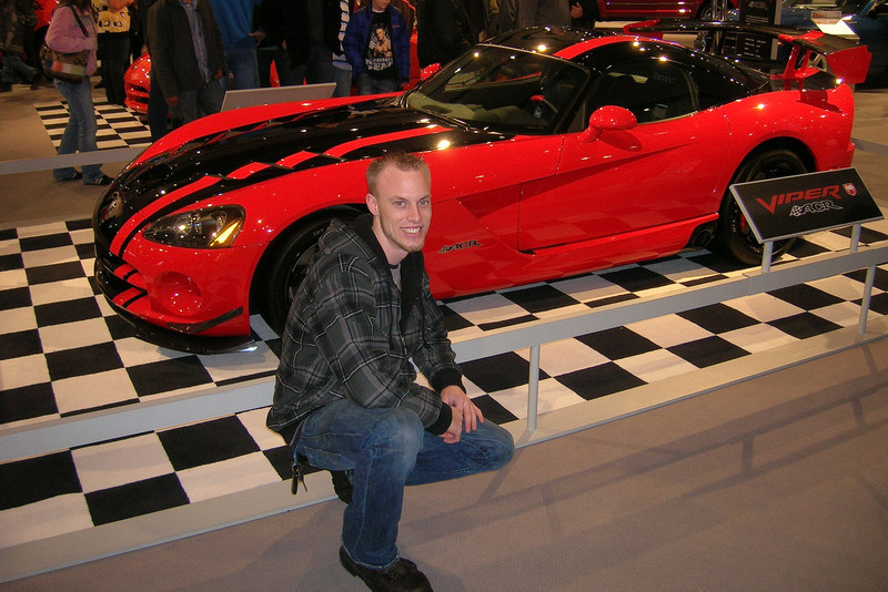 My son Eric in front of a Dodge Viper.  This photo was taken by his buddy Caleb at the North American International Auto Show, January, 2009.