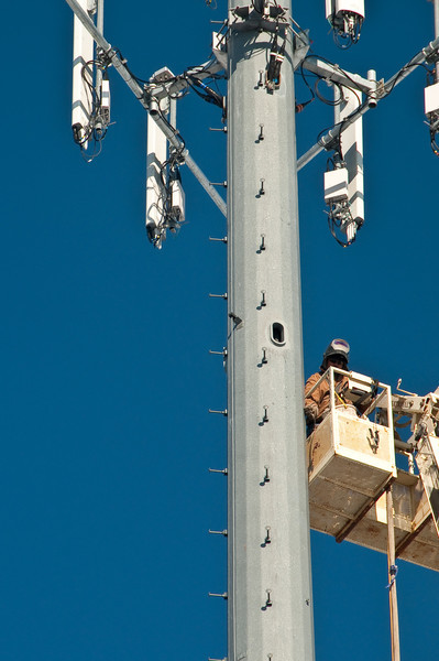 A crew working on a cell tower next to the township hall in Metamora, Michigan.