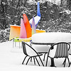 A piece of artwork and lots of snow in an outside dining area at the Valassis Corporate office (where I work) in Livonia, Michigan.