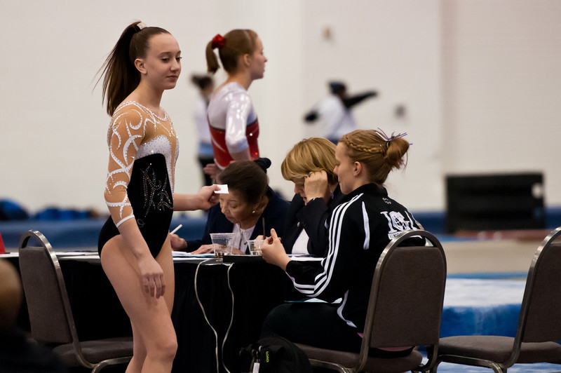 My niece Taylor at the judge's table, Chicago Style gymnastics meet, February, 2012