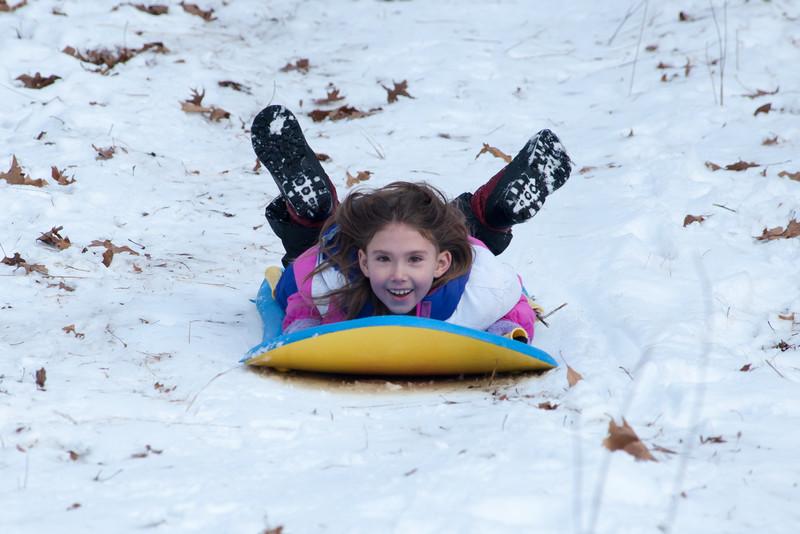 Young girl sledding at Bald Mountain.